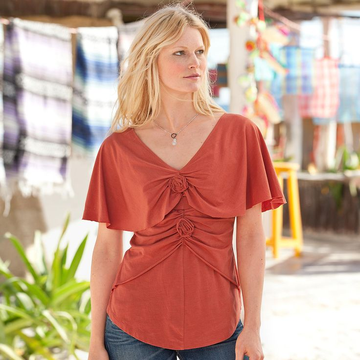 """ROSE CAPELET TEE--Rosettes, shoulder-sheltering capelet sleeves and a ruched peplum romance our jersey top. Raw edges add a modern vibe. Cotton/modal. Machine wash. Imported. Exclusive. Sizes XS (2), S (4 to 6), M (8 to 10), L (12 to 14), XL (16). Approx. 25-1/4""""L."""