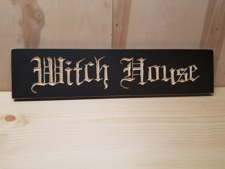 wooden carved witch halloween sign