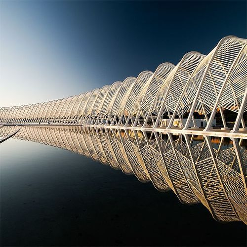Santiago Calatrava; what is nice about this is that the water reflects the bridge, emphasizing the repetition.