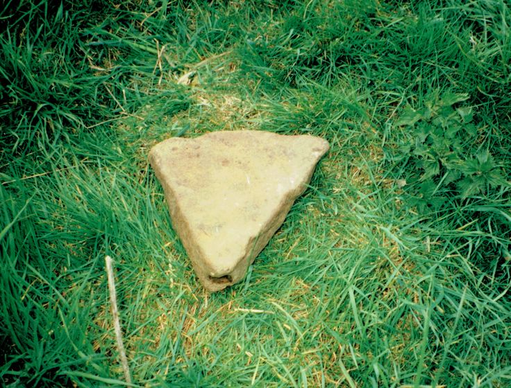 Triangle stone with a cupmark hollowed at the vertical edge of the apex. Found alongside a 1.4 tonne triangular megalith. Not far away were the breasts and head illustrated previously. British Neolithic. 5800 to 4000 years old. Full details will be given in THE LOST WORLD, by Terence Meaden.