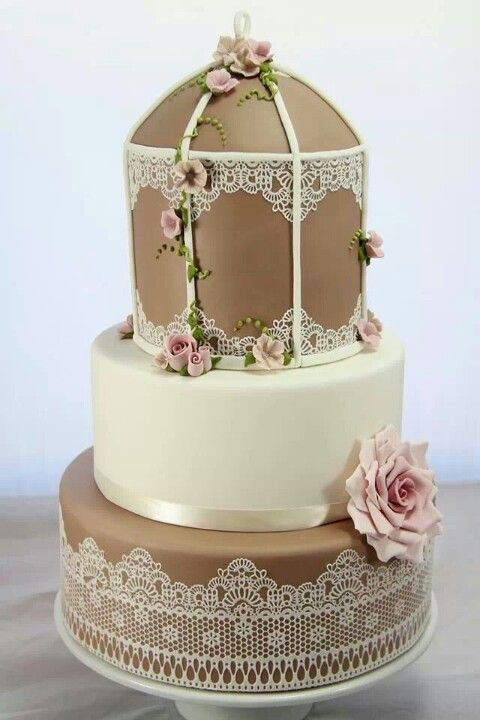 """Wedding cake in brown and beige with pink and lace accents. """"Arbor"""" shaped."""