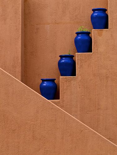 Southwest Style Wall with Blue Vases; Add character to the boring areas without adding more plant material. Could be built in wood, too.