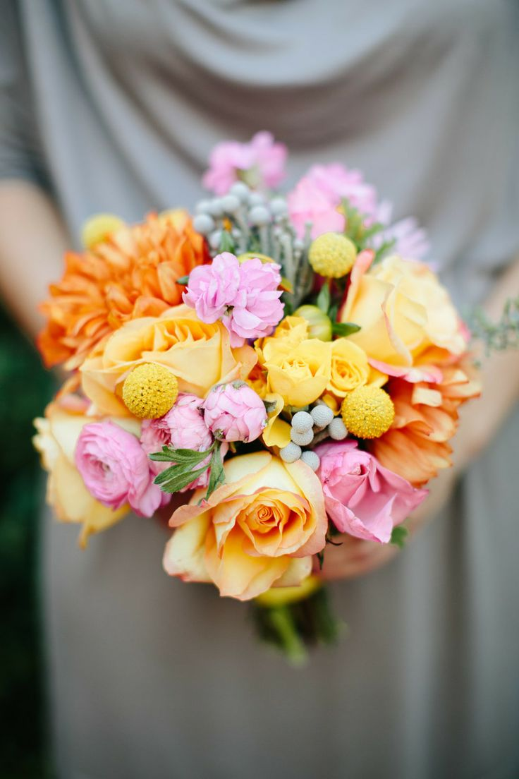 pretty colourful bouquet against the grey bridesmaids dress