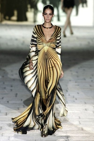 Roberto Cavalli. This is literal art, I think? Seems like Natural in the styling. Quite swirly for YangN, might look a bit floppy, with no structure, and the high waist would look odd. YinNatural? The sleeves do bat out into wings. It's not a red carpet look.