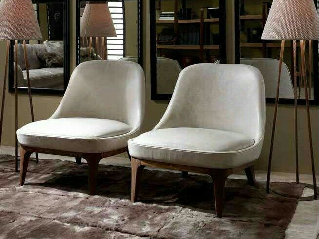 Upholstered Leather Armchair DORY Cosmopolitan Collection By Ulivi Salotti.  No Idea If These Are Attainable Or Not But I Like Them