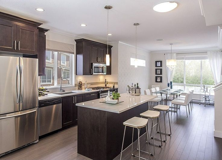 Traditional Kitchen With Flush Flat Panel Cabinets Gas Range Pendant Light One
