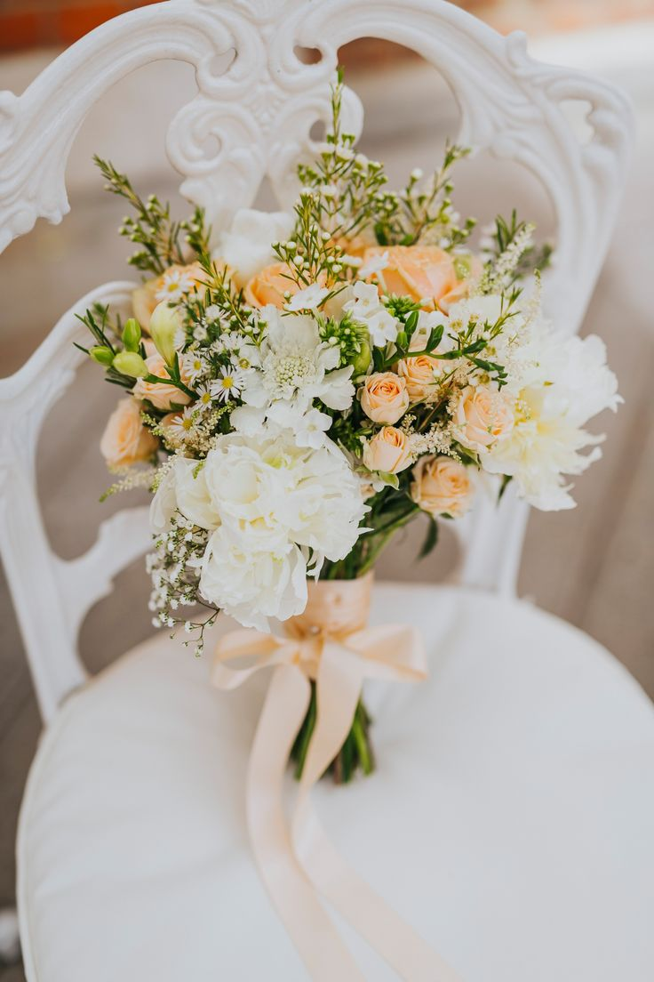 Beautiful blooms by Eclectic Bliss Events. Photo by Benjamin Stuart Photography #weddingphotography #eclecticblissevents #weddingflowers #bridalbouquet #handtiedbouquet