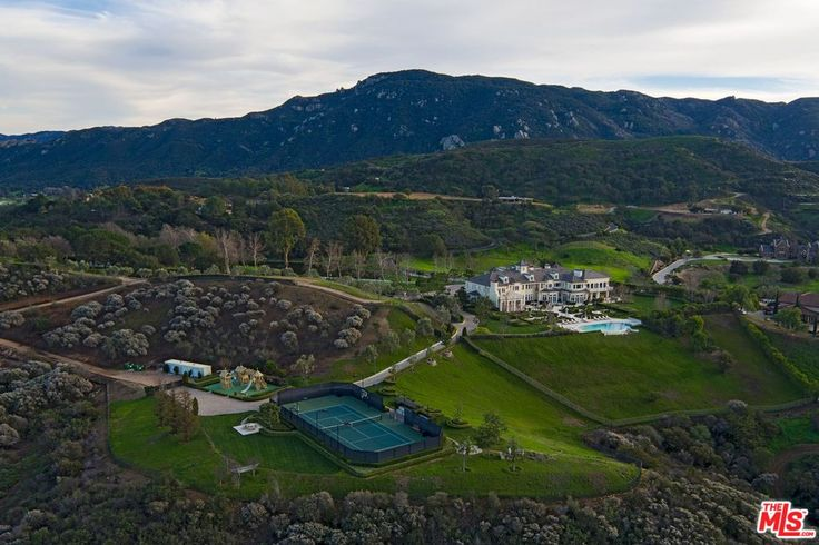 For sale: $18,900,000. Redesigned and renovated by designer Roy Sklarin, this luxurious French Formal estate is beautifully situated on over 20 spectacular acres of land. The palatial residence features 14,000 square feet of lavish living space, 7 bedrooms, 13 bathrooms, comprised of a deluxe master bedroom suite with dual baths, walk-in closets, a gourmet double-island kitchen and pantry, a wine connoisseur's tasting room, a theater, a gym, a separate guest quarters. The property is bein...