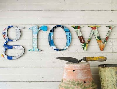 Use hobby lobby letters and floral scrapbook paper to put on wall above gardening stuff in garage