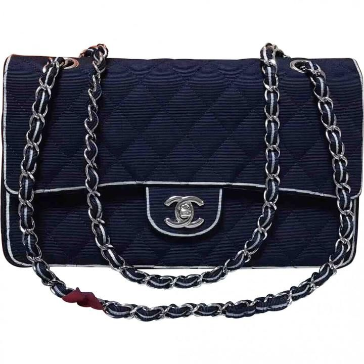 £2,222 - ULTRA RARE AND ABSOLUTELY STUNNING AUTHENTIC CHANEL LIMITED EDITION NAVY QUILTED CANVAS WHITE EDGING MEDIUM CLASSIC DOUBLE FLAP BAG WITH SPARKLING SILVERTONE HARDWARE!!! This bag is truly one of a kind and a must have collector's piece for all fashionistas!!! Bag is in excellent condition with very minor signs of use. #Ad