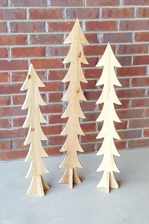These beautiful Rustic Christmas trees are perfect for any Porch, Patio, Entryway, and Living room. Each one is cut from Cedar which has a great aroma and very rot resistant. They can be hand painted with any paint.  Details  - 3 trees for $25  - Each one is a different size  - 6 x 36 / 6 x 33 / 6 x 30  - Unpainted  - Cedar  Christmas | Crafts | Parties | front porch | outside decoration | family fun | Wall Decor   Please feel free to ask any questions.  If shipping to Hawaii, Alask...