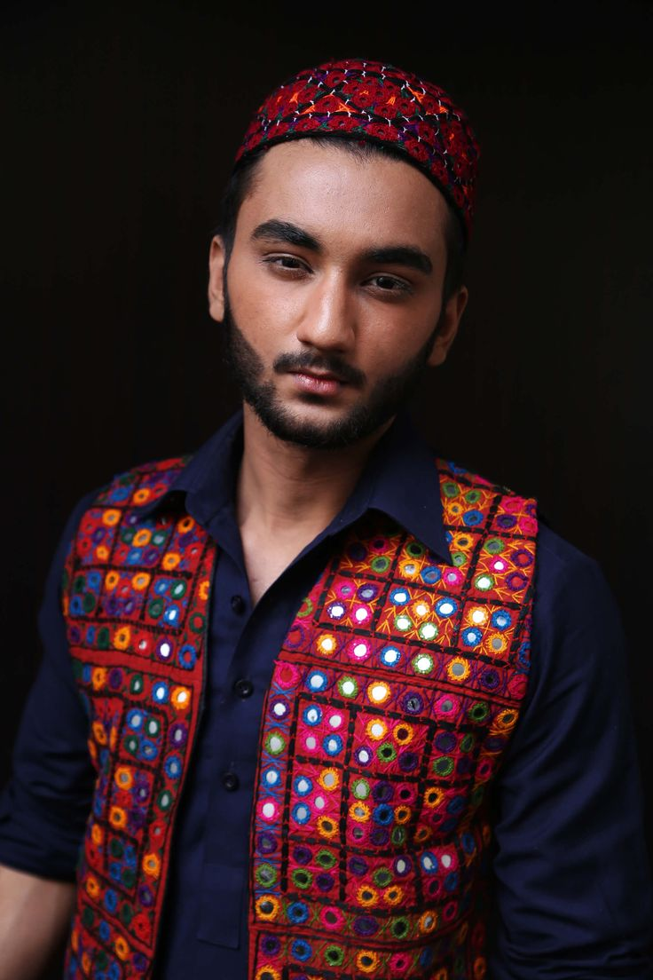 Multi color tilla design with embedded glass in velvet fabric representing Pakistani culture in stylish way.
