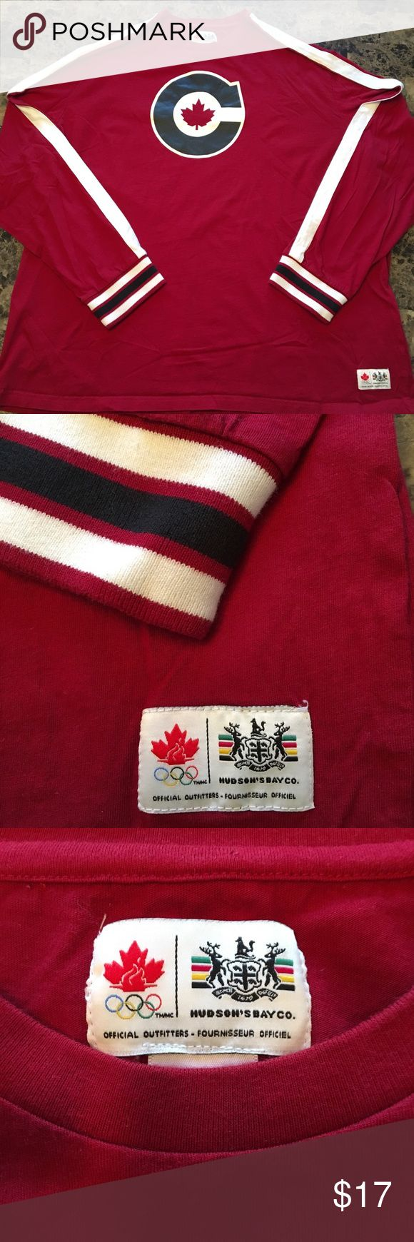 Team Canada Olympic shirt official Get ready for next years Olympic Games with this official team canada shirt. Like-new! This shirt features team Canada's logo on the chest with white striping along the entire sleeve, with white and black striped cuffs. Official Olympic logs on front and back. Please feel free to ask any questions, thanks. Hudson's Bay Shirts Tees - Long Sleeve