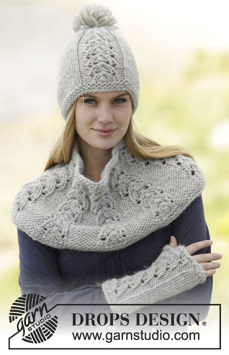"Set consists of hat with pompom, neck warmer and wrist warmers with lace pattern in ""Eskimo"". #knitting by #DROPSDesign"