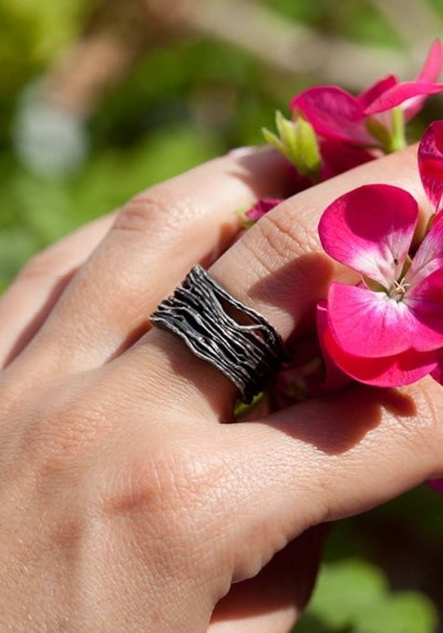 RING About 1,6 centimeters tall and weighs 10 grams.I polished the interior and some parts of the ring to a mirror shine while it has a strong black oxidization for a beautiful contrast.Very comfortable this sculptural ring which design is inspired by nature is once audacious and so stylish.It is available from size 10 to 18.