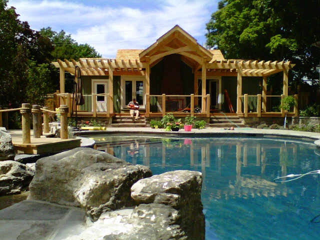 our Beautiful Pool House Construction #TimberFrame #Log #Custom #PoolHouse #DiscoveryDreamHomes