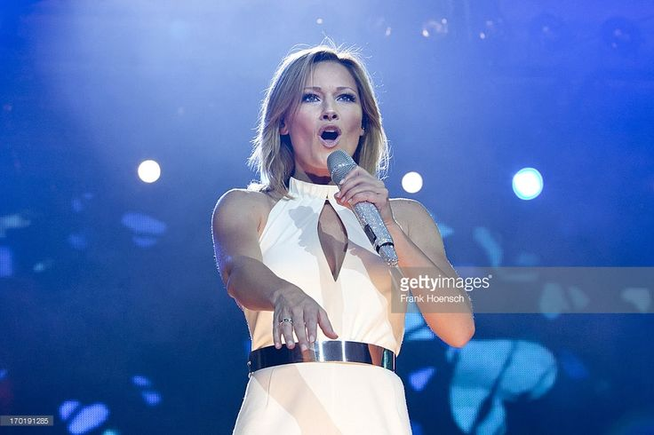 German singer Helene Fischer performs live during a concert at the Waldbuehne on June 8, 2013 in Berlin, Germany.