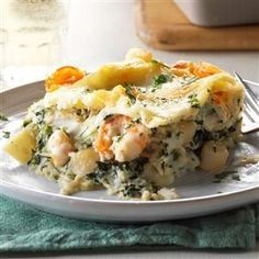 """White Seafood Lasagna Recipe -We make lasagna with shrimp and scallops as part of the traditional Italian Feast of the Seven Fishes. Every bite delivers a tasty """"jewel"""" from the sea. —Melba Wilson, Murrells Inlet, SC"""