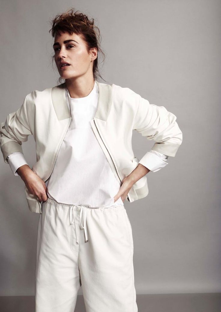 Yasmin le Bon looks minimal chic for the April cover shoot of Playing Fashion, lensed by Robert Harper.