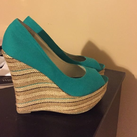 Teal wedges never worn. 5 inch wedge. DSW Shoes