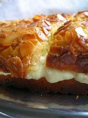 Recipe for Bee Sting Cake - If you like honey, this is the cake for you -- it's in the batter, the topping and filling. The topping is a honey-butter-almond topping, which creates a crispy, crackly top. It is sooo good.