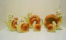 VINTAGE SNAPPY THE SNAIL ENESCO COLLECTION. TEAPOTS, SALT AND PEPPER, ASHTRAY