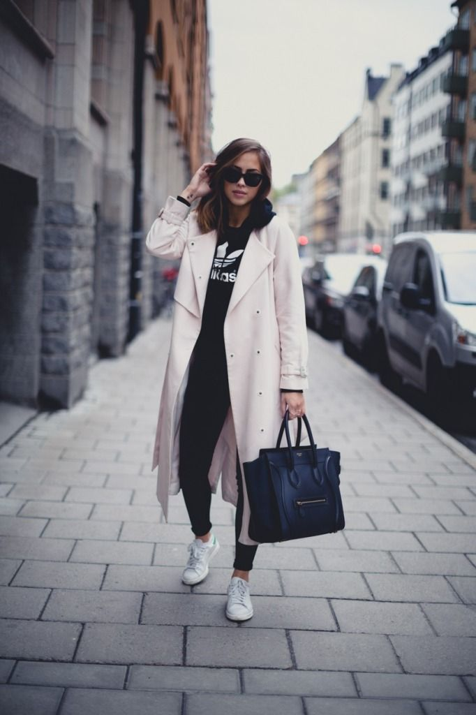 A long coat, sweatshirt, and sneakers make a perfect casual winter look.
