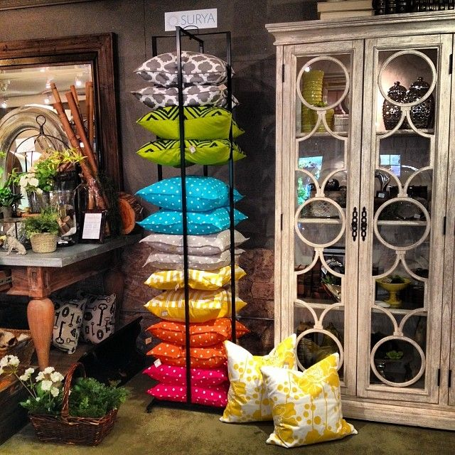 The Surya Pillow rack in action. Black-Eyed Susan shows off some colorful Surya pillows in their home decor store.