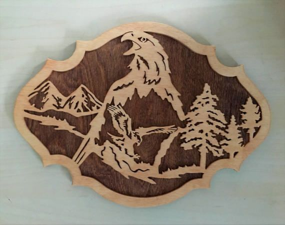 This eagle nature scene is a wooden plaque to hang on your wall.  Get just this one for $40 or get a set of three for $100.
