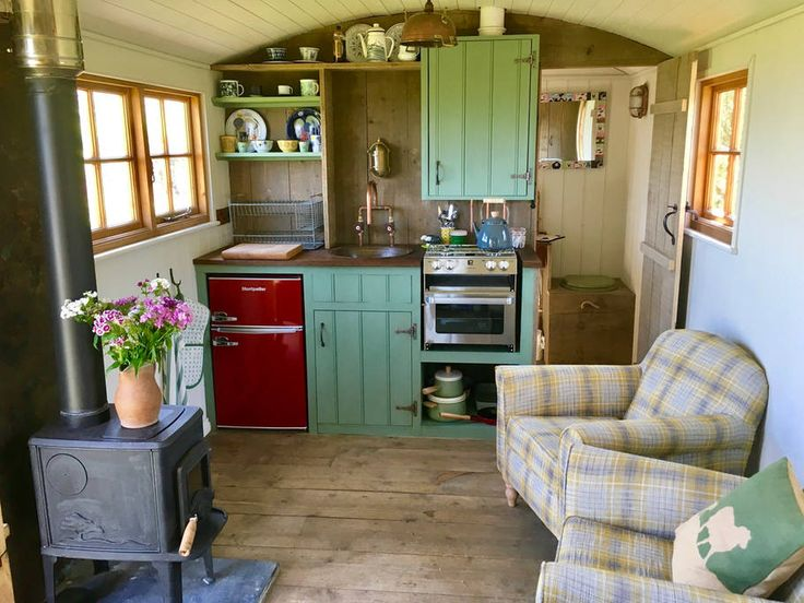 The kitchen area includes a gas stove, fridge, sink and simple cooking equipment