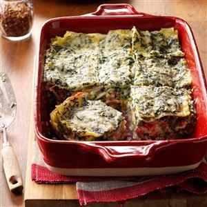 Four-Cheese Spinach Lasagna Recipe -This rich cheesy lasagna has become one of my specialties. It's packed with fresh-tasting vegetables like spinach, carrots, red pepper and broccoli. I'm never afraid to serve the colorful casserole to guests, since it's always a huge success. —Kimberly Kneisly, Englewood, Ohio