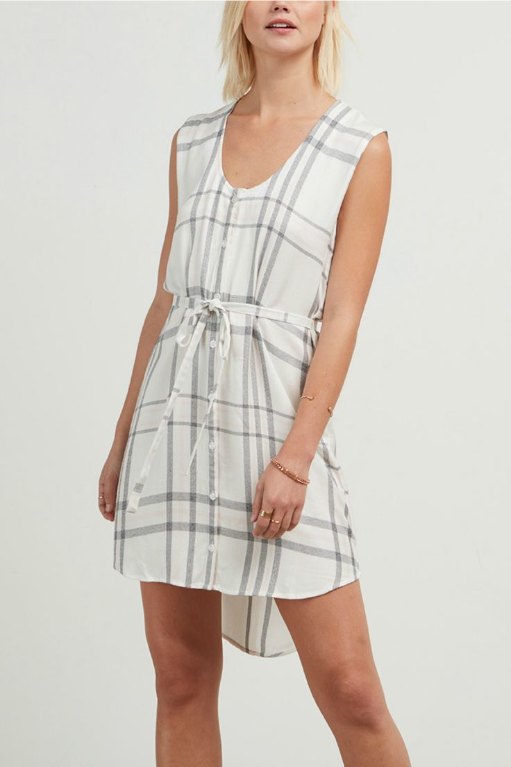 White plaid shirt dress with buttons down the front, a tie waist, and a high-low hemline. Pair with some cute wedges and your favorite necklace! Fit is true to size. 100% Rayon. Handwash or dry clean.