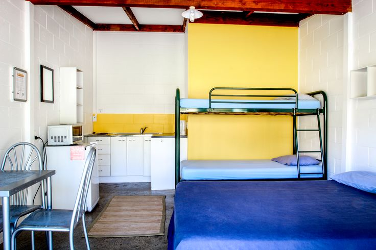 The Lodge | Russell- Orongo Bay Holiday Park. The kitchens have a microwave, fridge, cook top or frypan, toaster, electric jug, cutlery and crockery. All Lodge rooms with kitchens have a double bed, bunks and tables and chairs.  Beds are fitted with mattress protectors, fitted sheets, pillows and pillow slips. Guests supply or hire duvets or sleeping bag and towels. Guests share bathroom facilities.