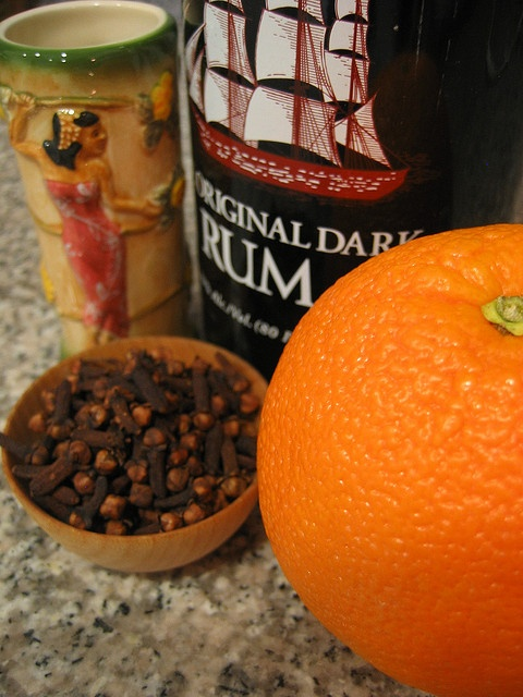 Madagascar: The 44 Cordial (Orange-and-Coffee-Flavored Rum Liqueur) > an orange pierced 44 times and stuffed with 44 coffee beans is added to a jar of rum (1 liter of white rum) that's been sweetened with 44 teaspoons of sugar. The concoction is   then left to steep for 44 days. It's a tropical adaptation of a homemade liquer that's popular in France, where it's called quatre-quatre and is sometimes made with cloves. Serve neat or over ice.  saveur.com