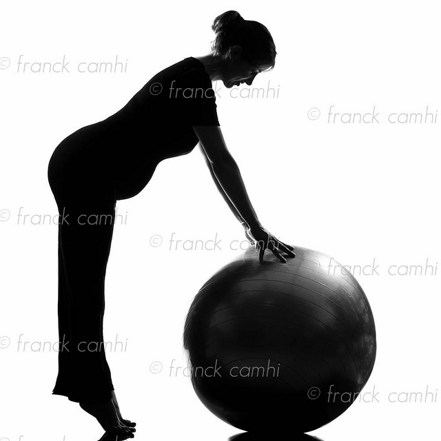 beautiful caucasian pregnant woman exercising fitness workut pilates with fitness ball in full length silhouette on studio isolated white background this is fantastic! Visit http://okbehealthy.com
