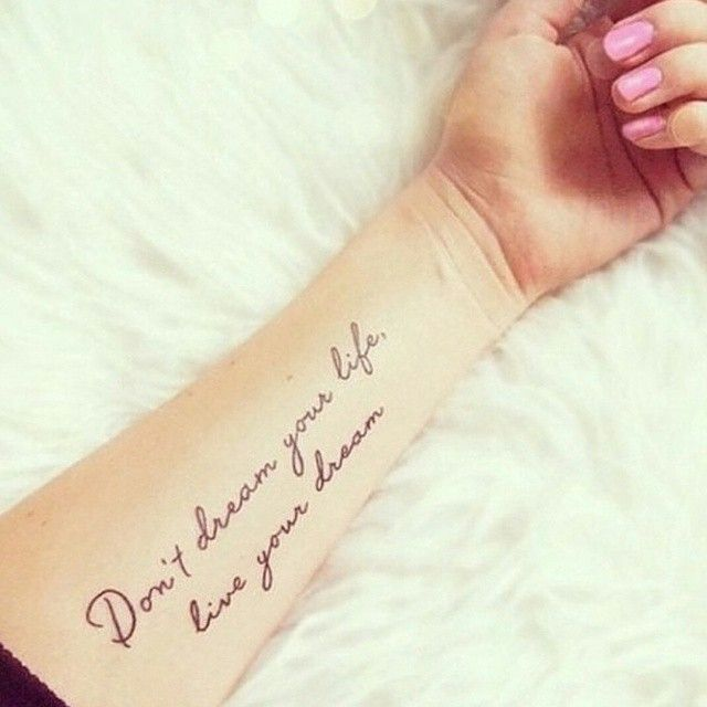 """Pin for Later: 44 Quote Tattoos That Will Change Your Life """"Don't dream your life, live your dream."""""""