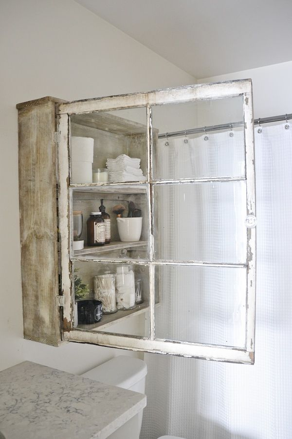 Learn how to create this charming DIY Window Cabinet for your bathroom or any space you need a little extra storage!