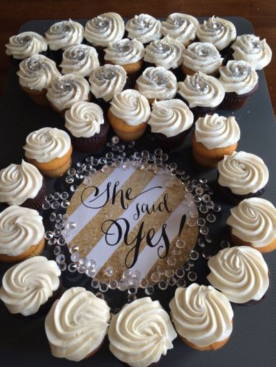 "Bridal shower dessert display idea - ""She said yes!"" cupcakes in the {Courtesy of One Stop Party Ideas}"