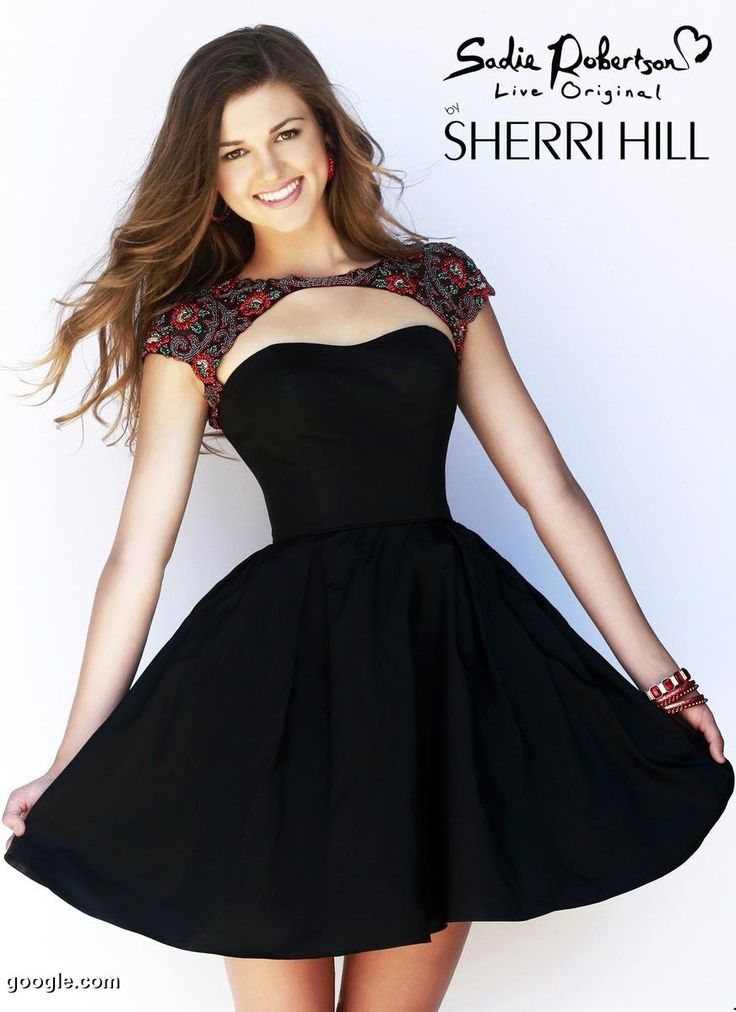 "Sadie Robertson Makes Major Announcement.  Robertson teamed up with fashion designer Sherri Hill to create the custom dresses. The collection is described as ""daddy approved"" — which means it balances fashion with modesty."
