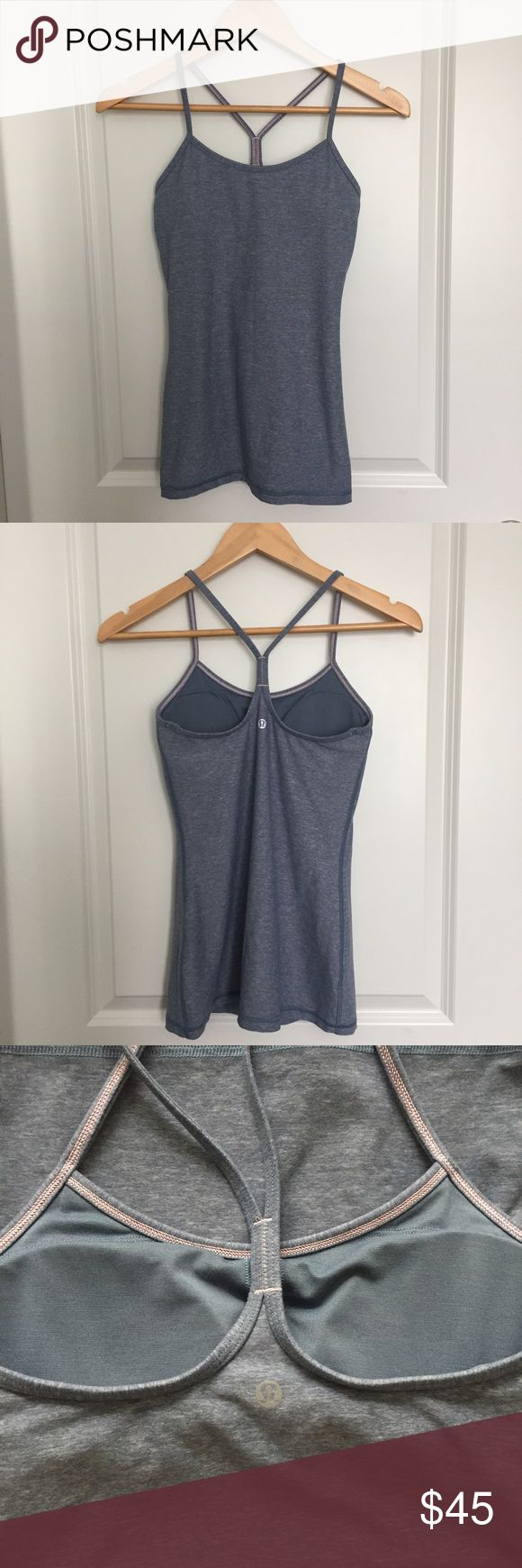 Lululemon Heathered Blue Denim Power Y Tank Beautiful light blue grey color. Good used condition with slight pilling on straps. Comes with bra cup inserts. Size 4. lululemon athletica Tops