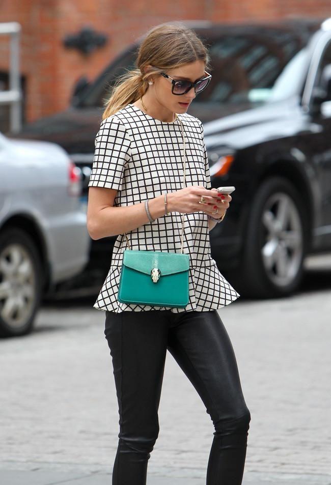 Olivia Palermo rocks checkered peplum and a pop of color crossbody bag.
