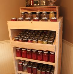 Canning Pantry holds over 200 quarts and pints of canned goods from our garden...made from old pallets.