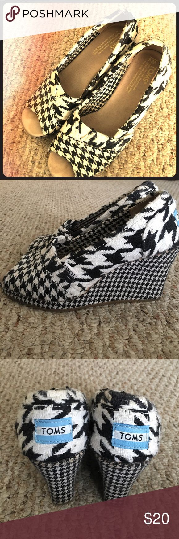 Toms black and white wedge shoes. Toms black and white wedge shoes. In preowned condition. Please see pictures TOMS Shoes Wedges