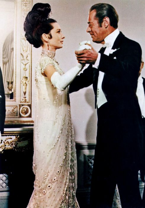 """She could of danced all night with Rex Harrison. In """"My Fair Lady,"""" Audrey described the 'absolutely divine dress' that Cecil Beaton designed for the transformed cockney flower girl to wear at the ball.  'All I had to do was walk down the stairs. The dress is what made me do it.'  When she put on the glittering beaded dress, she became Lady Eliza..""""(taken from the book Audrey Style)."""