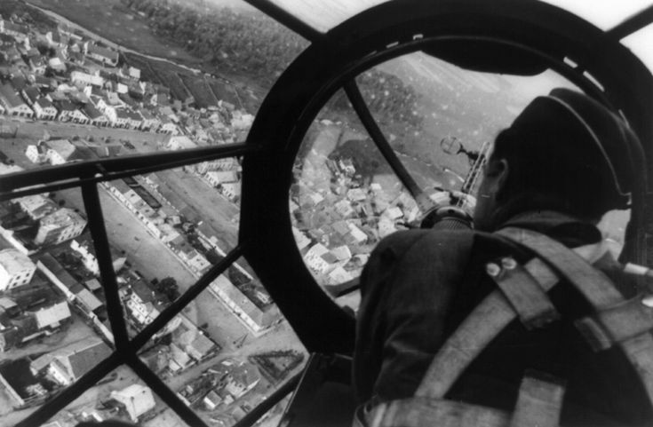 Aerial view of a Polish city through the gunner's station aboard a German He 111 bomber, September 1939.