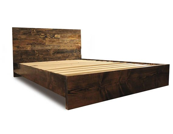This beautiful solid wood platform bed frame is built by hand and made to last a lifetime. Unique variations in wood grain is to be expected, ensuring a truly one-of-a-kind piece of bedroom furniture.   Looking for a matching nightstand? Find one here: https://www.etsy.com/listing/289525025/rustic-reclaimed-wood-style-nightstand - Shoot us a message for even more options and sizes!  PIECES AND PARTS: Modern and rustic solid wood headboard Thick solid wood footboard an...