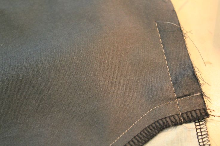 side of pocket is tacked to trouser front to secure it in place and prevent the pocket from moving.