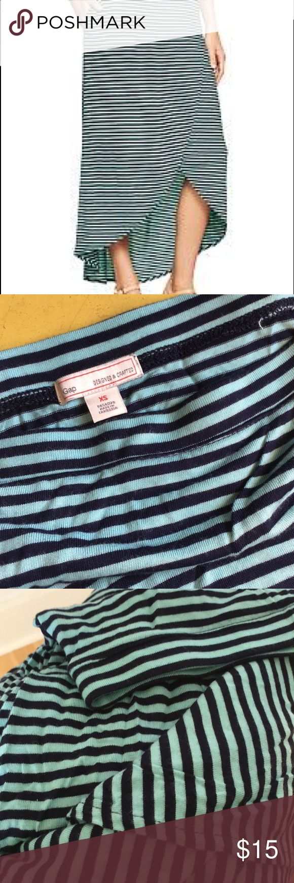"""NWOT XS GAP aqua/navy striped tulip hem skirt NWOT great condition GAP skirt. Skirt is an aqua and navy stripe color and has pockets! The skirt crosses over the front to make the """"tulip"""" and is a high/low length. GAP Skirts Midi"""