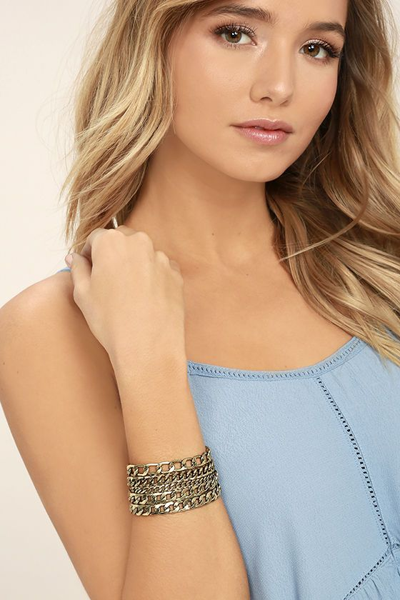 """The Dream Sequence Gold Chain Bracelet is more perfect than we imagined! Five rows of interlocking gold chains in varying sizes meet parallel T-bar ends. Bracelet measures 5.75"""" long with a 2.5"""" extender chain."""