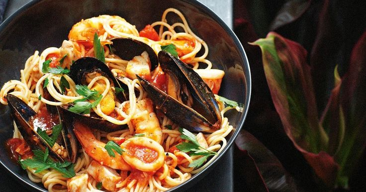 Take a shortcut with a good marinara mix or choose your own favourite seafood.